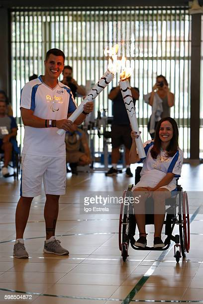 Paraplegic patient Mariana Guedes and Frederico Neto pass the flame at the International Center for Neuroscience and Rehabilitation SARAH on...