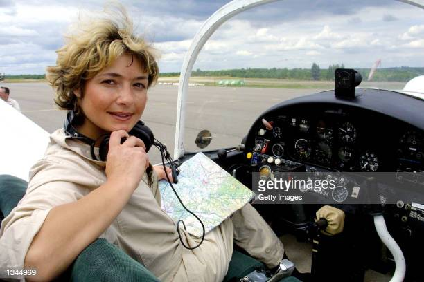 Paraplegic pilot for the fire and rescue department, Dorine Bourneton, sits in the cockpit of her plane August 19, 2002 in Cahors, France. Bourneton...