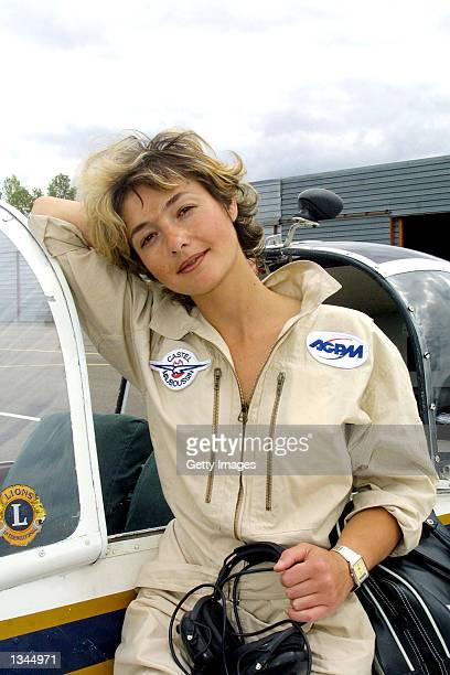 Paraplegic pilot for the fire and rescue department, Dorine Bourneton, poses next to the cockpit of her plane August 19, 2002 in Cahors, France....