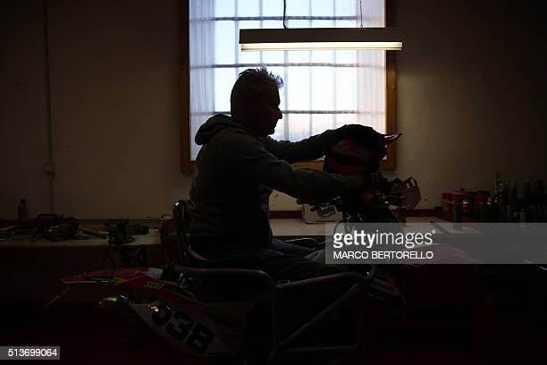 Paraplegic professional rider Nicola Dutto sets a bike in his garage on March 3 2016 in Beinette near Cuneo northern Italy Nicola Dutto currently an...