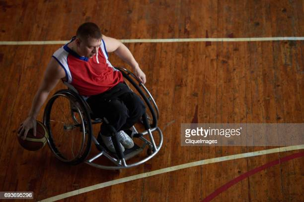 paraplegic sportsman dribbling basketball - cliqueimages stock pictures, royalty-free photos & images