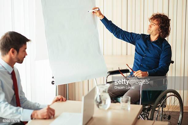 Paraplegic student and professor assistant in lecture hall