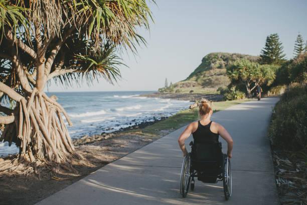 Paraplegic woman by the ocean