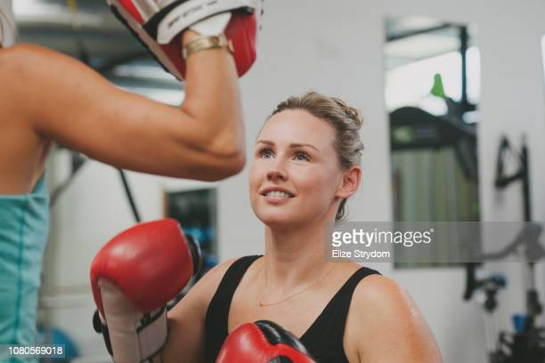 paraplegic woman in a gym - women's boxing stock pictures, royalty-free photos & images
