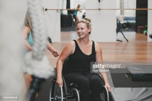 Paraplegic woman in a gym
