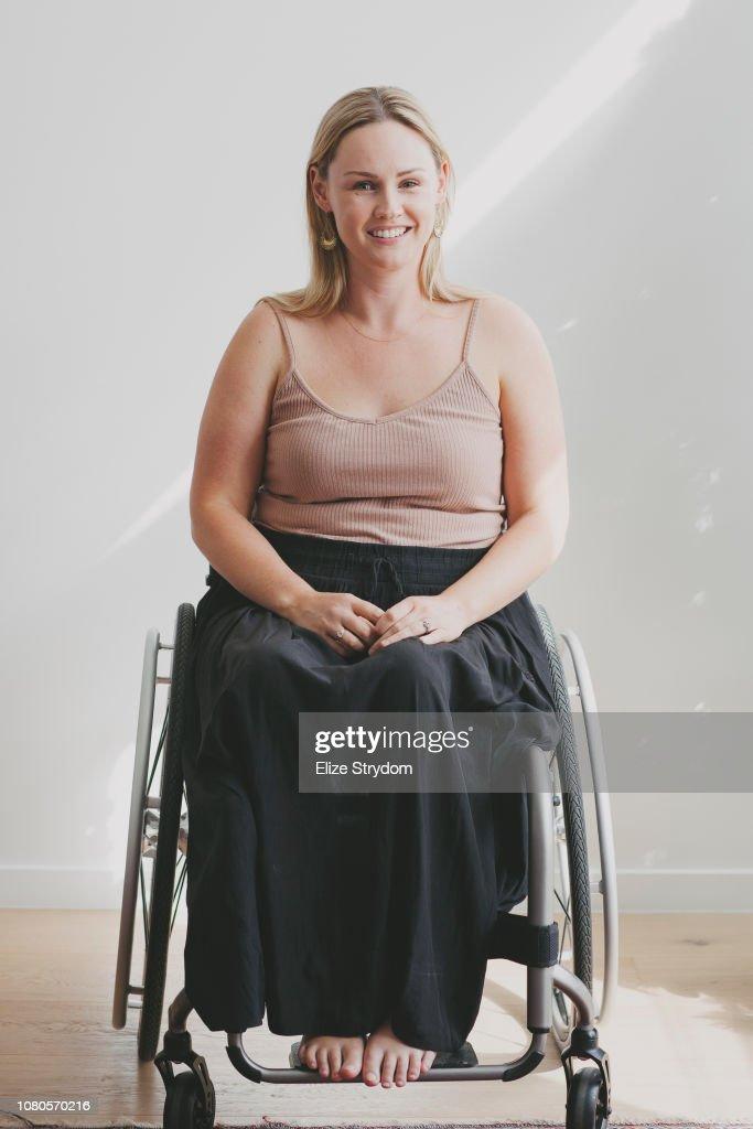 Paraplegic woman in her wheelchair : Stock Photo