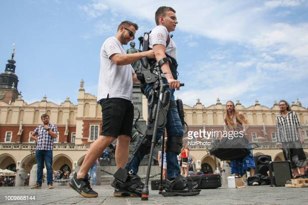 A paraplegic young man Marcin walks throught the Main Square during a demonstration of exoskeleton Krakow Poland on 1 August 2018