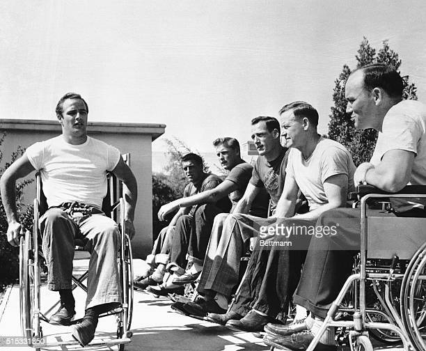 Paraplegics at the Birmingham Veterans Hospital in California 'pass judgement' on the way Marlon Brando handles himself in a wheelchair in December...