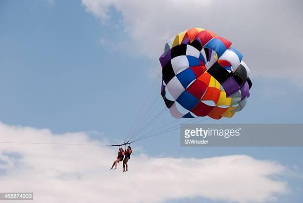 parasailing above big bear lake in southern california - big bear lake stock photos and pictures