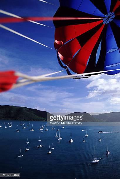 parasailing above the british virgin islands - islas de virgin gorda fotografías e imágenes de stock