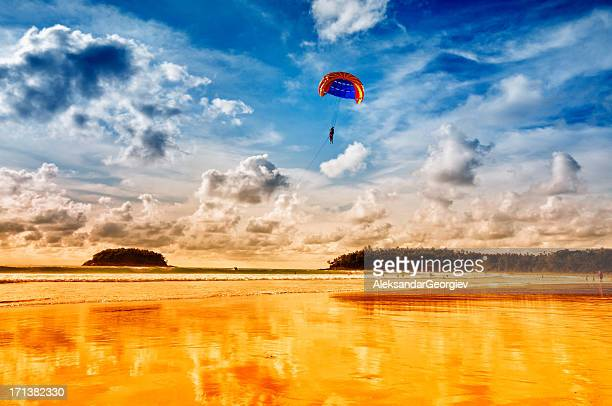 parasailing in the summer - gliding stock photos and pictures