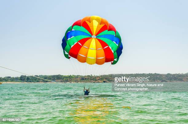 parasailing - goa stock photos and pictures