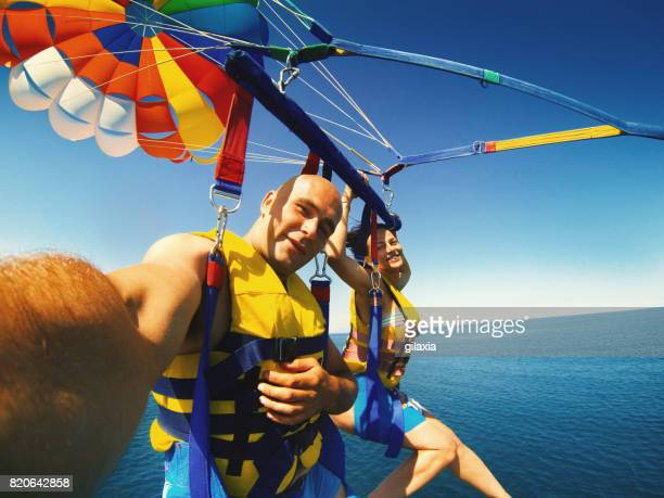 parasailing. - jet ski stock pictures, royalty-free photos & images