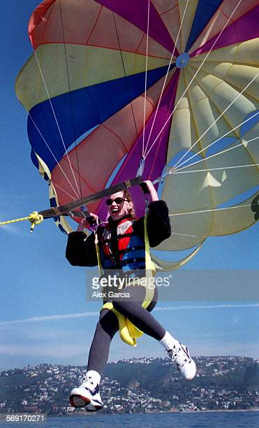 LSparasailscream0201AAG––As the rope pulls her in Cheri LeDuc lets out a yell of excitement after completing her first parasailing experience in the...