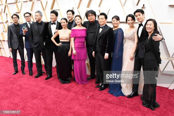 Parasite cast and crew attends the 92nd Annual Academy Awards at Hollywood and Highland on February 09 2020 in Hollywood California