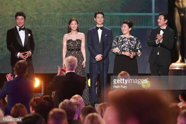 Parasite cast members Song Kangho Cho Yeojeong Choi Wooshik Lee Jungeun Chang Hyaejin and Lee Sunkyung present a clip of Parasite onstage during the...