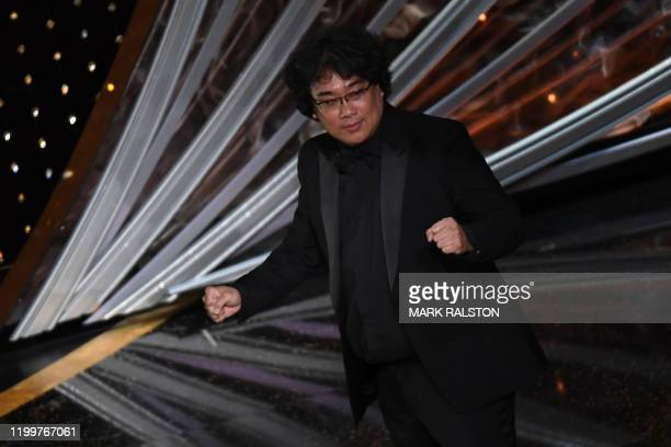 Parasite producer and director Bong Joonho celebrates after winning the award for Best Picture for Parasite during the 92nd Oscars at the Dolby...