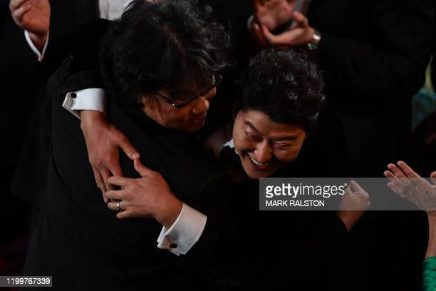 Parasite producer and director Bong Joonho celebrates with South Korean actor KangHo Song after winning the award for Best Picture for Parasite...