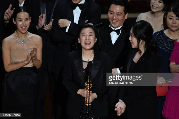 Parasite producer Kwak Sinae accepts the award for Best Picture for Parasite during the 92nd Oscars at the Dolby Theatre in Hollywood California on...