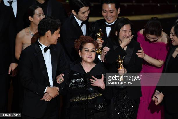 Parasite producer Kwak Sinae alongside cast and crew accept the award for Best Picture for Parasite during the 92nd Oscars at the Dolby Theatre in...