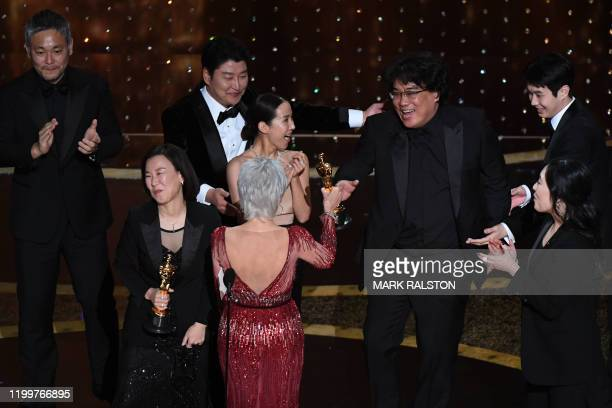 TOPSHOT Parasite producers Kwak Sinae and Bong Joonho accept the award for Best Picture for Parasite during the 92nd Oscars at the Dolby Theatre in...