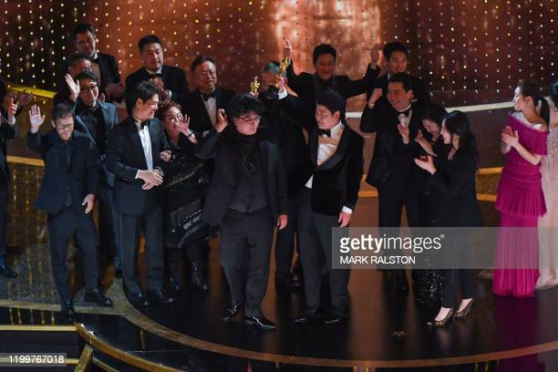 Parasite producers Kwak Sinae and Bong Joonho accept the award for Best Picture for Parasite during the 92nd Oscars at the Dolby Theatre in Hollywood...