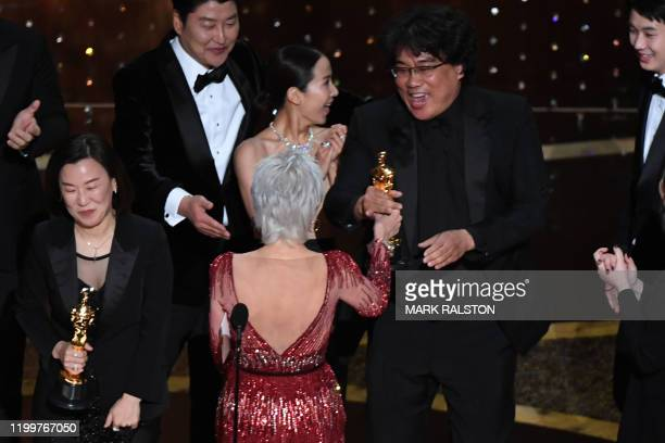 Parasite producers Kwak Sinae and Bong Joonho are greeted by US actress Jane Fonda as they accept the award for Best Picture for Parasite during the...