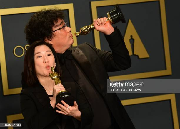 Parasite producers Kwak Sinae and Bong Joonho pose in the press room with the Oscars for Parasite during the 92nd Oscars at the Dolby Theater in...