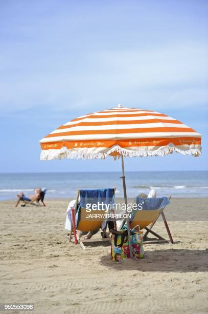 Parasol and lounge chairs on the beach, Trouville, Calvados department, Normandy region, France.