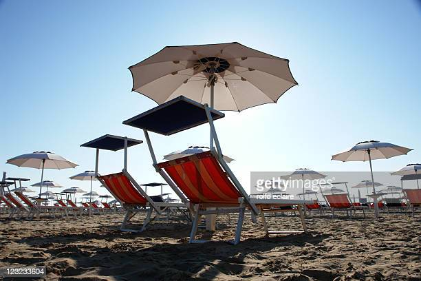 Parasol and sun loungers at beach