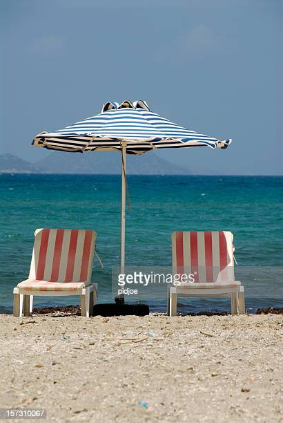 parasol and two beach chairs