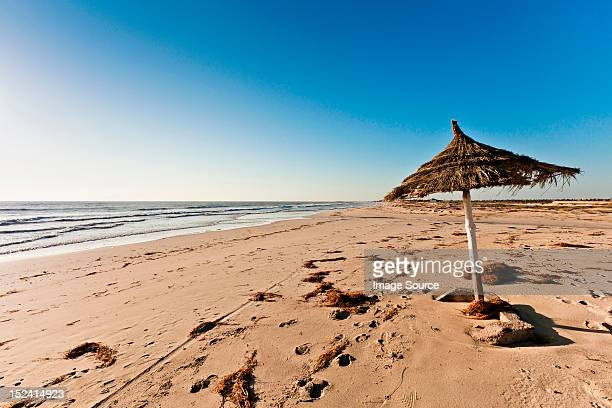 parasol on beach on island of djerba, tunisia - djerba stock pictures, royalty-free photos & images