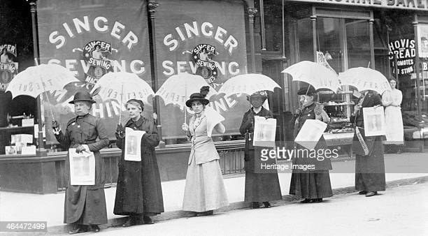 A parasol parade selling The Suffragette newspaper Brighton Sussex April 1914 From left to right Miss Reid Mrs Goodier Miss Gye Mrs Brandon Miss Rae...