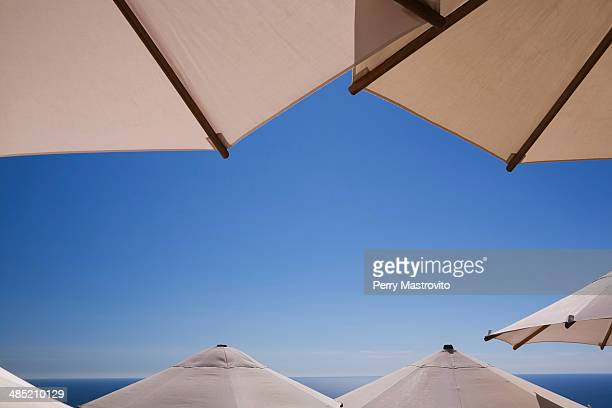 Parasols with clear blue sky and sea