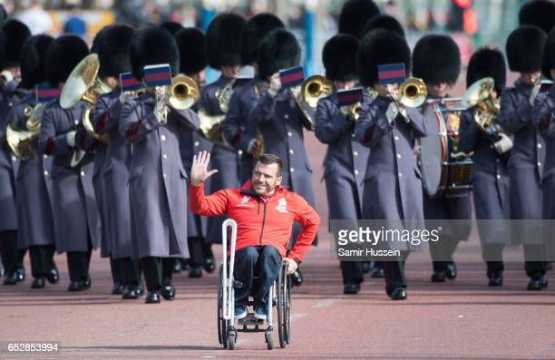 Parathlete Kurt Fearnley carries the Commonwealth baton on his wheelchair during the launch of The Queen's Baton Relay for the XXI Commonwealth Games...