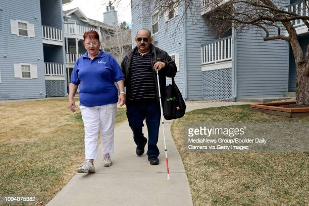 Paratransit driver Dar Owsianny helps Jesse Soto of Longmont get to a VIA Mobility Services vehicle from his apartment Thursday March 6 2014 Soto...
