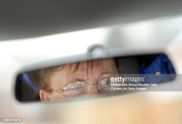 Paratransit driver Dar Owsianny is seen in the rear view mirror of a VIA Mobility vehicle as she drives Thursday March 6 in Longmont