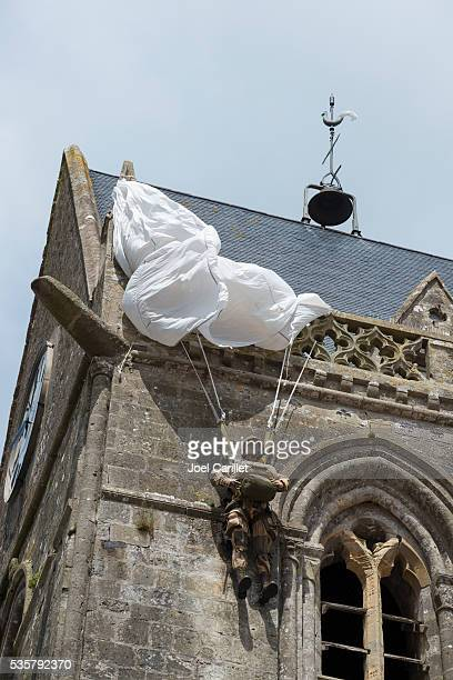Paratrooper caught on Sainte-Mere-Eglise church, Normandy, France