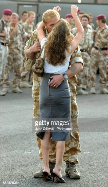 Paratrooper Corporal Paul Potts and his wife embrace after his return to Merville Barracks in Colchester following a tour of duty in Afghanistan