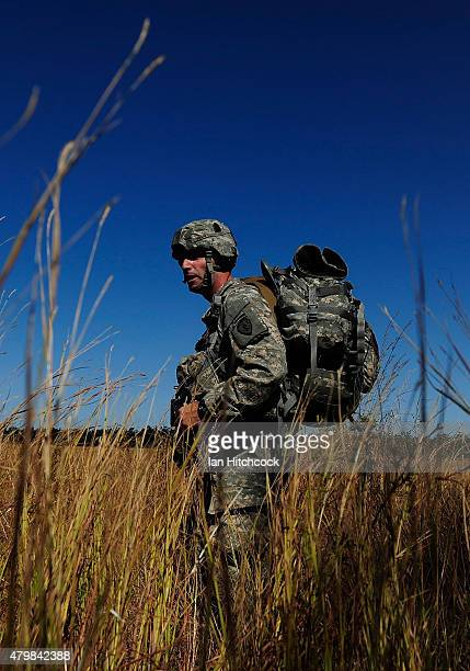 Paratrooper from the 4/25th Infantry Division walks towards his rally point after making a jump from a C17 Globemaster as part of exercise Talisman...