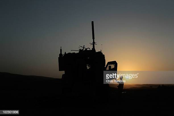 A paratrooper in the 4th Brigade of the US Army's 82nd Airborne Division enters an MRAP vehicle at dawn after overnighting in a field during a...