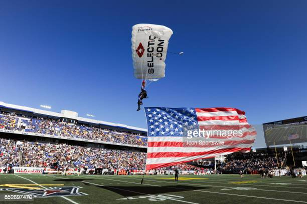 A paratrooper lands on the field on September 23 at Navy Marine Corps Memorial Stadium in Annapolis MD The Navy Midshipmen defeated the Cincinnati...