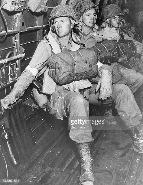 US paratroopers all geared to begin the smashing Allied assault on Sicily are calm as their big transport draws close to the Italian island