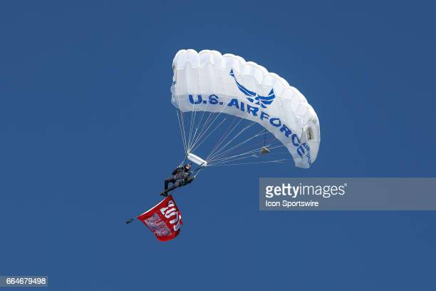 Paratroopers descend prior to the MLB opening day baseball game between the Texas Rangers and Cleveland Indians on April 3 2017 at Globe Life Park in...