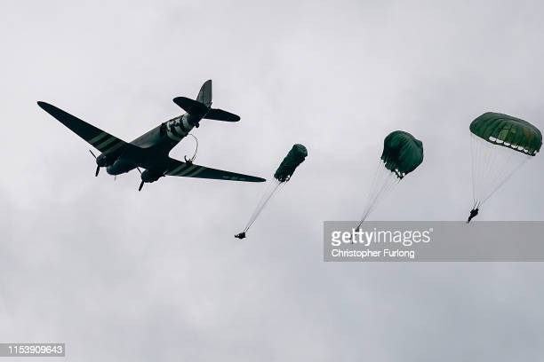 Paratroopers from the DAKS Historical Association take part in a parachute drop onto fields at Sannerville on June 05 2019 in Sannerville France...