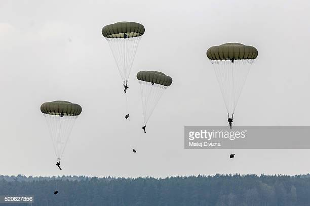 Paratroopers from the U.S. Army 173rd Airborne Brigade, the UK's 16 Air Assault Brigade and Italian Folgore Airborne Brigade parachute to the ground...