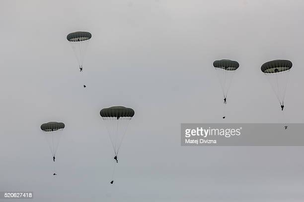 Paratroopers from the US Army 173rd Airborne Brigade the UK's 16 Air Assault Brigade and Italian Folgore Airborne Brigade parachute to the ground...