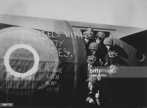 Paratroopers give the thumbsup signal before leaving in a glider to drop on Normandy as reinforcements to the invasion forces