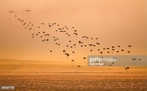 Paratroopers jump out of C130 planes during Exercise Golfinho September 7 2009 in Lohatla South Africa Close to 6500 troops police and supporting...