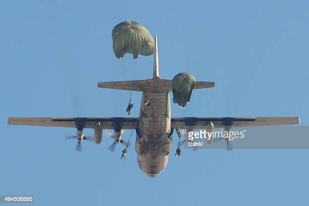 paratroopers jumping from c130 airplane - paratrooper stock pictures, royalty-free photos & images